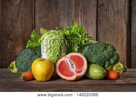 Set of different vegan foods on the old wooden background vegetables fruit vegetarian concept