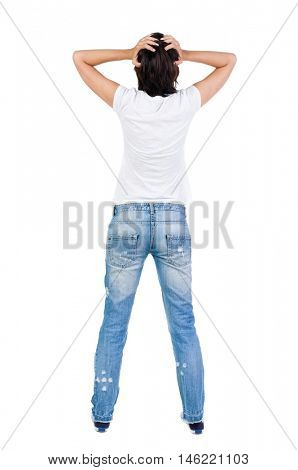 Back view of shocked woman in blue jeans. girl hid his eyes behind his hands.  Rear view people collection.  backside view of person.  Isolated over white background.