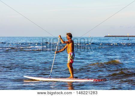 Kijkduin beach the Netherlands - September 01 2016: Male stand up board paddler