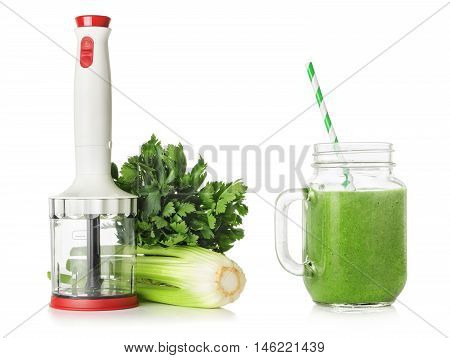 Blender stems and leaves of celery green smoothies isolated on white background healthy eating concept