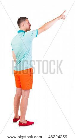Back view of  pointing young men in  t-shirt and shorts. Young guy  gesture. Rear view people collection.  backside view of person.  Isolated over white background.