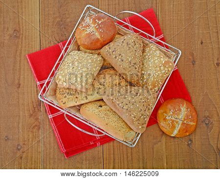 bread rolls in basket on the table wtih red napkin