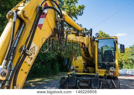 Excavator Bright Yellow Blue Sky Construction Equipment Industrial