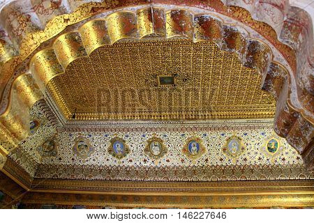 Ornamental micro etching and golden color painting on roof at Meharongarh Fort in Jodhpur Rajasthan India Asia