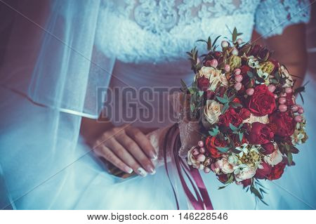 Bride in White Dress Holding Splendid Bridal Boquet Colorful