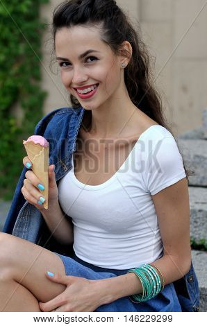 Close-up Portrait Of A Girl Eating Ice Cream