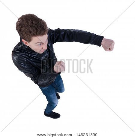 skinny guy funny fights waving his arms and legs. Isolated over white background. Top view of a fighting man