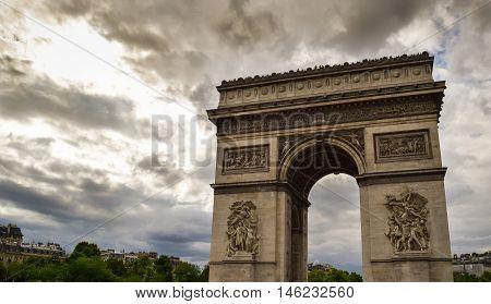 Triumphal arch in Paris city at sunset. Arc de Triomphe in Paris France. Famous Paris view on triumphal arch.