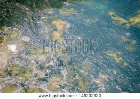 sea polluted by the action of man