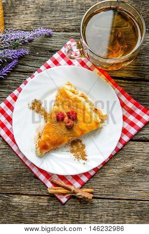 delicious pie with cottage cheese with raspberry, cup of green tea