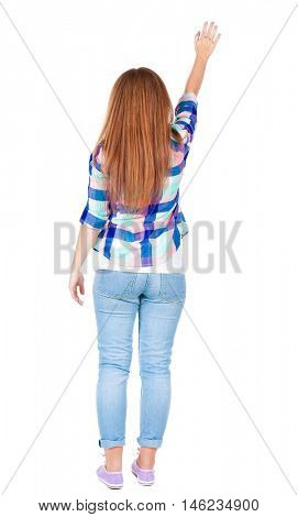 woman happily greets someone. girl waving. Rear view people collection.  backside view of person.  Isolated over white background.