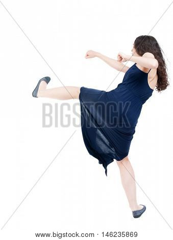 skinny woman funny fights waving his arms and legs. dark curly girl in blue evening dress waving his arms and legs.