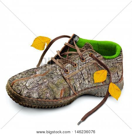 Eco-friendly shoes. Concept. Shoes made of natural materials. Winter shoes from the bark of a tree, grass and leaves. Isolated over white background.