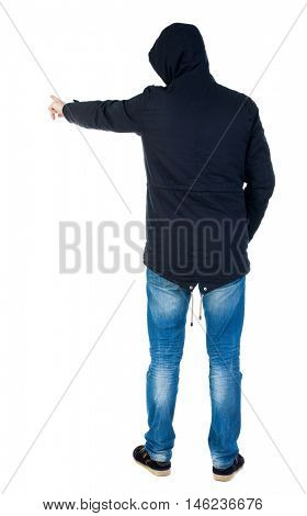 Back view of  pointing young men in parka. Young guy  gesture. Rear view people collection.  backside view of person.  Isolated over white background. Man in warm jacket hood pulled on his head is and