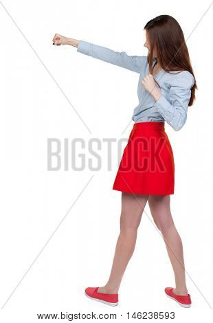 skinny woman funny fights waving his arms and legs. Long-haired brunette is cancer and has boxed in a red skirt