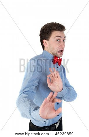 The guy in a shirt and bow tie locked arms experiencing negative emotions. Scared businessman in a shirt and bow tie in horror.
