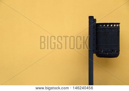 Metallic trash can on yellow background without shadow