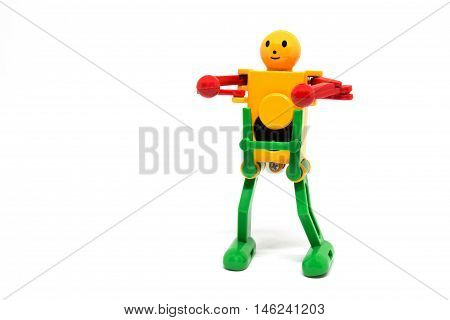 closeup robot toy winder on white background