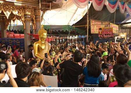 SAMUT PRAKAN,THAILAND - OCTOBER 26,2015 : Unidentified peoples enjoy carrying Buddha statue from the boat on End of Buddhist Lent Day in Rub Bua Festival ,Samut Prakan Province, Middle of Thailand.
