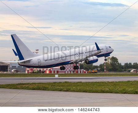 modern airplane take off close-up rear view
