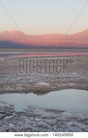 Sunset in Atacama Salar, Chile / Salt lake and mountains at Atacama Salar, Chile