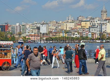 ISTANBUL TURKEY SEPTEMBER 29: People in Galata Karakoy quarter of Istanbul, Turkey and historic architecture and medieval Galata tower.On september 29 2013 in Istanbul Turkey