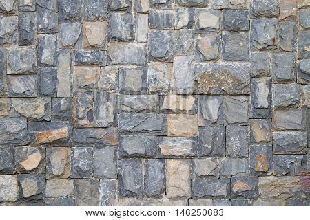 ancient rustic gray and old stone wall texture