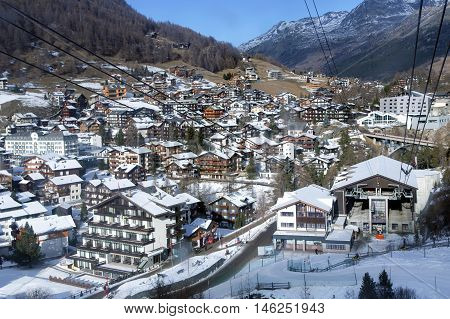 SWITZERLAND, SAAS-FEE, DECEMBER, 26, 2015 -Cable ski lifts on the background of the most popular ski resort of Saas-Fee is located in the south of Switzerland, near mount Valpelline. He was surrounded by thirteen peaks over 4,000 meters high.