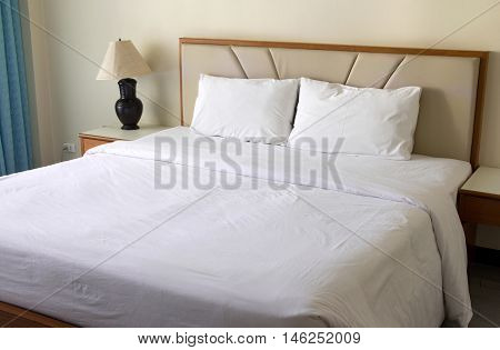 Bedroom Interior With Pillow And Table Lamp