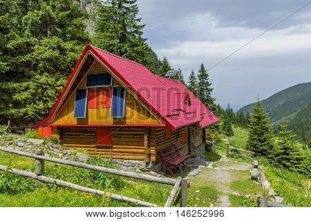 Mountain chalet with solar panels. Green energy.