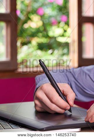 Man Hand Using Designer Tablet