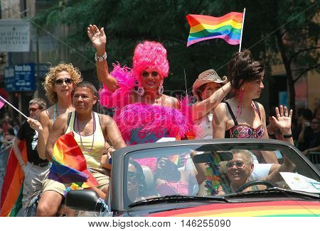 New York City - June 25 2005: Women riding on the 1969 Stonewall Uprising automobile at the 2005 Gay Pride Parade on Fifth Avenue