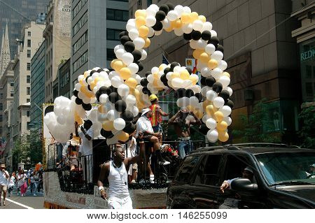 New York City - June 25 2005: Black white and gold balloon arches adorn a float at the 2005 Gay Pride Parade on Fifth Avenue