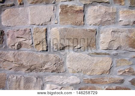 Dry stone wall of an old quarry stone house in Belgium