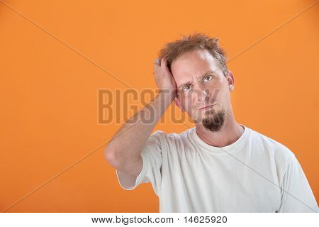 Man With Hand On Head