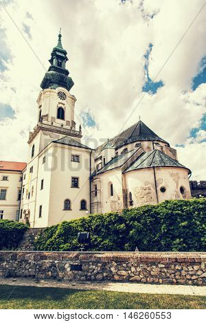 Ancient castle in Nitra Slovak republic. Cultural heritage. Architectural theme. Retro photo filter. Place for worship. Vertical composition.