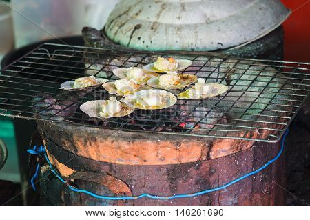 grilling scallops with butter on grill, seafood