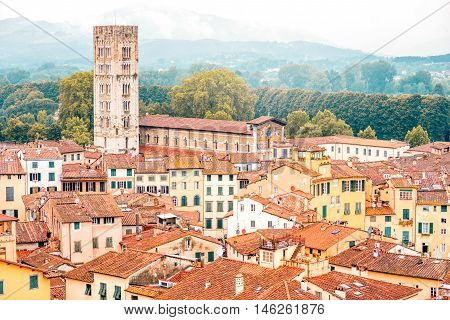 Aerial cityscape view on the old town of Lucca with San Frediano basilica tower in Italy