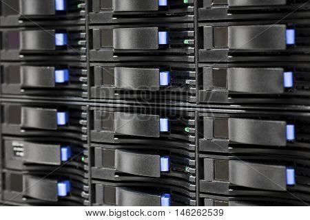 Full frame shot of SAN storage with harddrives in server room