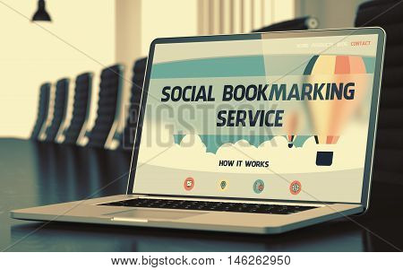 Modern Meeting Hall with Laptop Showing Landing Page with Text Social Bookmarking Service. Closeup View. Blurred Image with Selective focus. 3D Illustration.