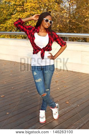 Beautiful Smiling African Woman Wearing A Sunglasses, Red Checkered Shirt Posing Evening
