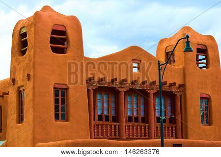 Historic adobe style building with observation towers taken in Santa Fe, NM
