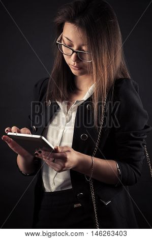 young teenage Korean girl with a tablet in hands