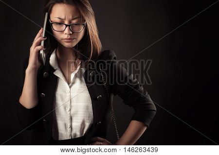 frustrated teenager girl talking on mobile phone