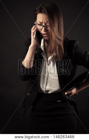 teenager girl talking on mobile phone isolated on black background