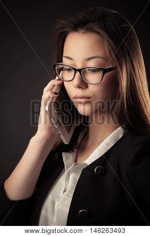 Korean beautiful teenage girl talking on mobile phone