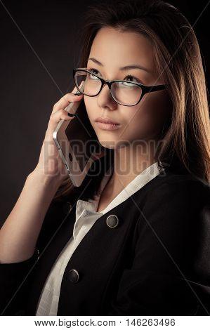 portrait Korean teenage girl talking on mobile phone