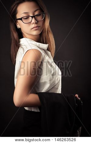beautiful teenager girl in blouse and business suit