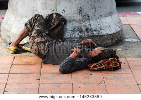 Homeless Man Sleep On Pavement