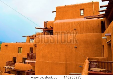 Adobe style building with a combination of historic and modern architectural design taken in Santa Fe, NM